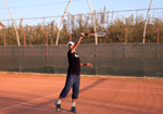 how to avoid hitting tennis overhead into the net