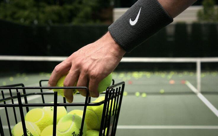 how to become a better tennis coach
