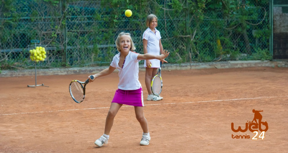 children having fun playing tennis